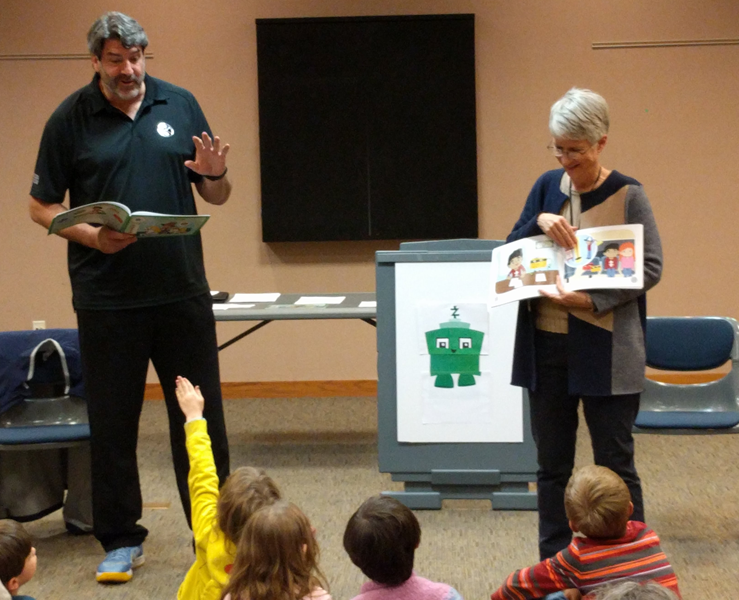 Wendy Boortz reading a book to kids